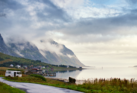 Norway villages in fjord on lofoten islands. Cloudy Nordic day.