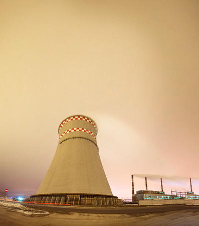Thermal power plant and cooling towers at night near the city Stock Photo