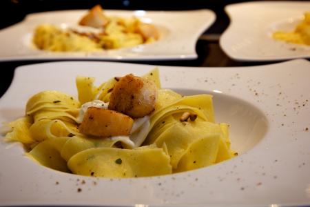 Pasta with Scallops Standard-Bild