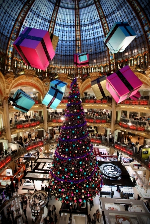 lafayette: Paris, France, December 17, 2010 - Christmas Tree with gifts at Lafayette department store in Paris