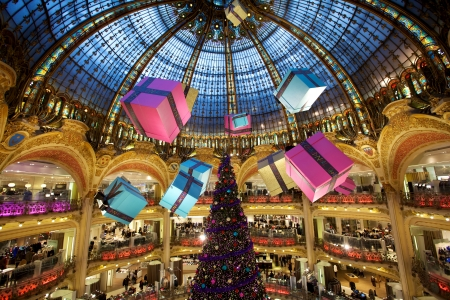 Paris, France, December 17, 2010 - Christmas Tree with gifts at Lafayette department store in Paris