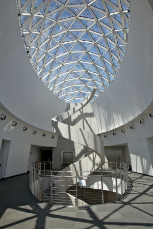 view of an atrium in a building: St. Petersburg, Florida, USA - July 30, 2011: Interior of the new Salvador Dali Museum. The helicoidal staircase reminding a DNA structure, with the Enigma Glass structure above.