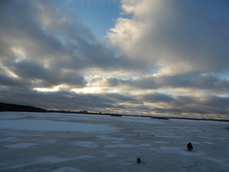 frozen lake: Frozen lake and winter clouds in December Stock Photo