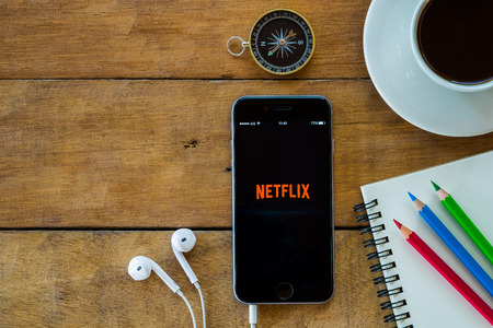 american media: CHIANGMAI, THAILAND -MAY 15,2016:Netflix apps showing on iphone 6s.Netflix is an American provider of on-demand Internet streaming media available founded in 1997 by Marc Randolph and Reed Hastings