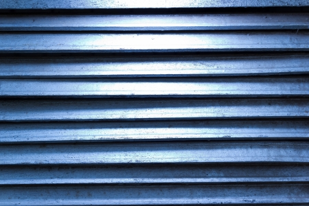 Blue grunge texture of old iron shutters ventilation Stock Photo - 16718782