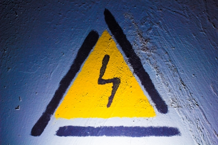 Electric danger Signal lightning in the blue metal texture photo