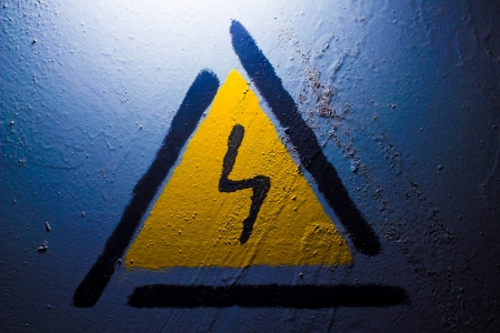 Electric danger Signal lightning on a blue background Stock Photo - 16747084