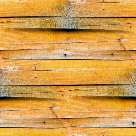 shadowy: seamless texture of the wooden fence of the old yellow Stock Photo