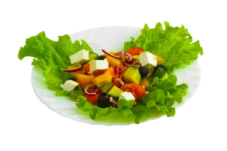 Fresh salad with tomatoes, cucumbers and peppers with cheese and herbs on a white background (clipping path) Stock Photo - 16862576