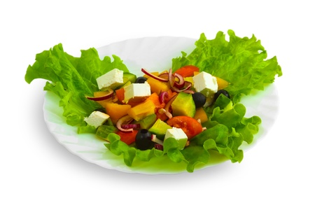 Fresh salad with tomatoes, cucumbers and peppers with cheese and herbs on a white background photo