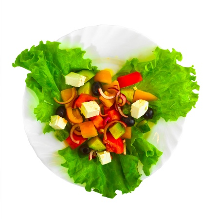 Fresh salad with tomatoes, cucumbers and peppers with cheese and herbs on white background (clipping path) Stock Photo - 16863222