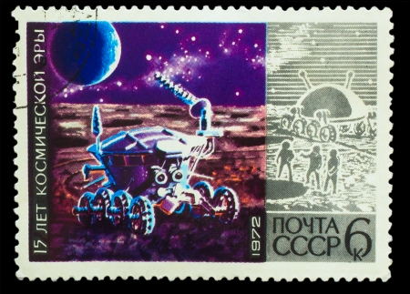 space age: USSR - CIRCA 1972 : stamp printed in USSR, 15 years of space age, spacecraft explores surface of moon, circa 1972 Editorial
