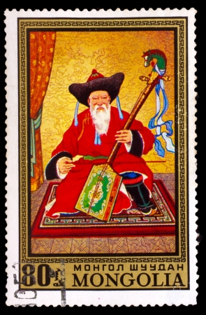 stringed instrument: MONGOLIA - CIRCA 1972: A stamp printed by MONGOLIA , old man in the Mongolian national dress playing a stringed instrument violin - morin Huur, circa 1972 Editorial