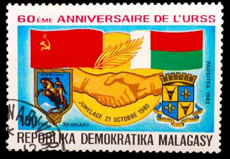 soviet flag: MALAGASY - CIRCA 1982: A stamp printed in MALAGASY, Democratic Republic of Malagasy, Soviet flag and Malagasy, handshake hand, circa 1982