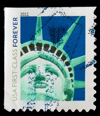UNITED STATES OF AMERICA - CIRCA 2011: A stamp printed in USA, shows Statue of Liberty, usa first -class forever, circa 2011 photo