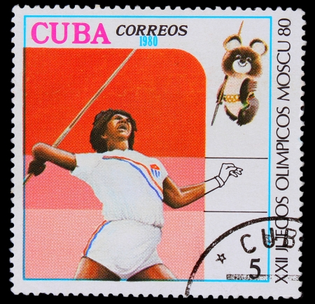 cuba girl: CUBA - CIRCA 1980: A stamp printed in CUBA, devoted to Games in Moscow (1980), javelin throwing, girl dark skin throws a spear, circa 1980 Editorial