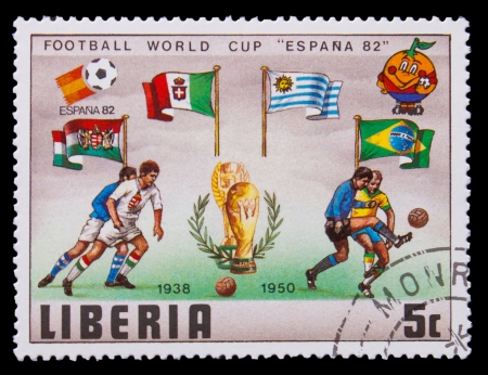 LIBERIA - CIRCA 1982: A post stamp printed LIBERIA, Brazil, Argentina and Italy Flags of Soccer Cup FIFA 82 Trophy Coupe du Monde, circa 1982