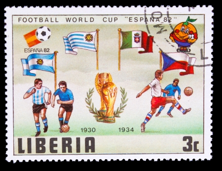 LIBERIA - CIRCA 1982: A post stamp printed LIBERIA, Argentina, Italy Flags of  Soccer Cup FIFA  82 Trophy Coupe du Monde, circa 1982