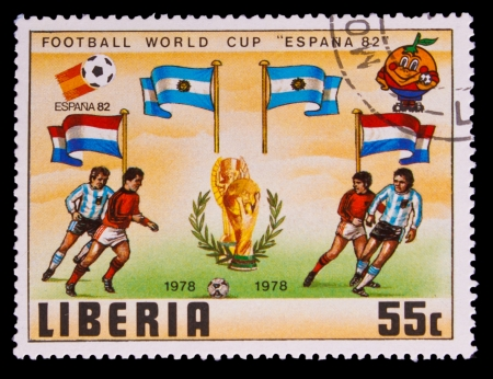 LIBERIA - CIRCA 1982: A post stamp printed LIBERIA, Argentina, Netherlands Flags of Soccer Cup FIFA 82 Trophy Coupe du Monde, circa 1982