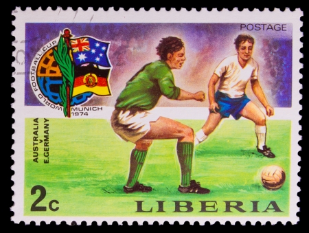 LIBERIA - CIRCA 1974: A post stamp printed LIBERIA, Australia v. Germany football in Munich, Germany, circa 1974