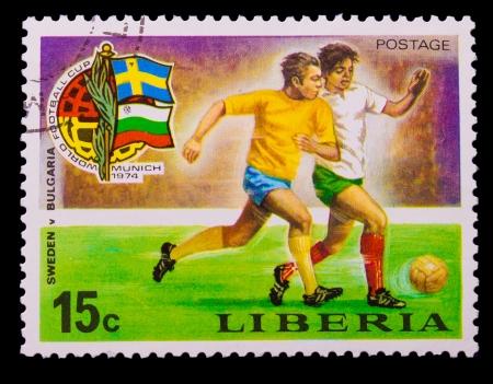 education in sweden: LIBERIA - CIRCA 1974: A post stamp printed LIBERIA, Bulgaria vs. Sweden soccer  in Munich, Germany , circa 1974