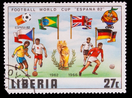 LIBERIA - CIRCA 1982: A post stamp printed LIBERIA, Spain, Brazil, Britain and Germany Flags of the Soccer Cup 82 Trophy Coupe du Monde, circa 1982