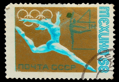 USSR - CIRCA 1968: A stamp printed in USSR, gymnastics,  Games in Mexico, thlete gymnast performs a jump, circa 1968 Stock Photo - 16896187