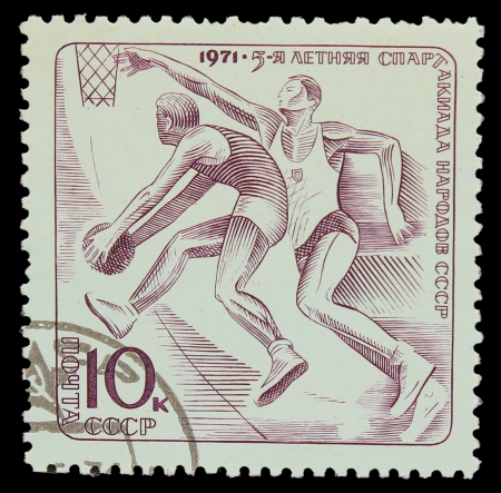 USSR - CIRCA 1971: A stamp printed in USSR, 5-year sports day of the USSR, basketball, basketball player with the ball, circa 1971 Stock Photo - 16896254