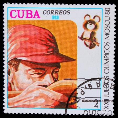 CUBA - CIRCA 1980: A stamp printed in CUBA, devoted  Games Moscow (1980), sports shooting,man shoots gun, circa 1980 Stock Photo - 16896375