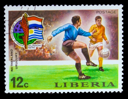 LIBERIA - CIRCA 1974: A post stamp printed LIBERIA, Netherlands vs. Uruguay Soccer  in Munich, Germany, circa 1974
