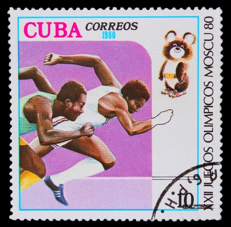 CUBA - CIRCA 1980: A stamp printed in CUBA, two athletes running Negro competition, circa 1980 Stock Photo - 16896371