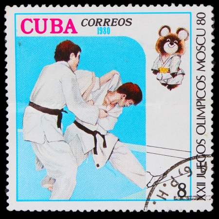 CUBA - CIRCA 1980: A stamp printed in CUBA, devoted Games Moscow (1980), fight judo ,athlete shall throw technique, circa 1980 Stock Photo - 16896366