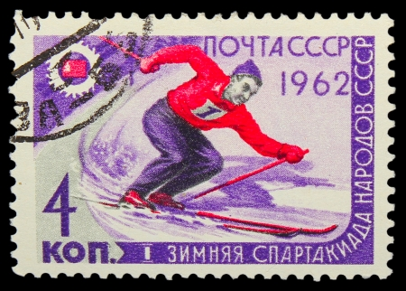 USSR - CIRCA 1962: A stamp printed in USSR,  first winter Games of the USSR, mountain slalom, skier, circa 1962 Stock Photo - 16896196