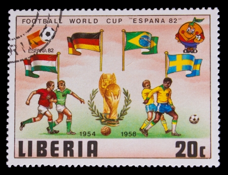 LIBERIA - CIRCA 1982: A post stamp printed LIBERIA, Sweden, Germany and Brazil Flags of Soccer Cup FIFA 82 Trophy Coupe du Monde, circa 1982