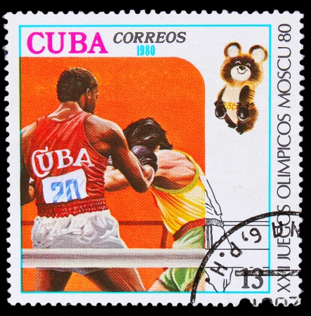 CUBA - CIRCA 1980: A stamp printed in CUBA, devoted  Games in Moscow (1980) and shows Boxing, two boxers in ring, circa 1980 Stock Photo - 16896378