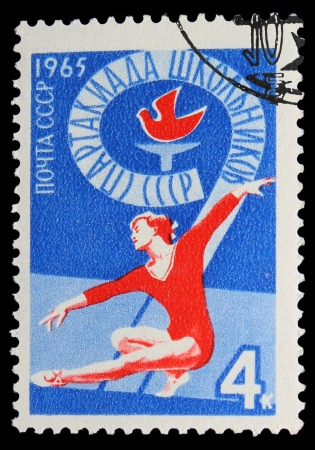 USSR - CIRCA 1965: A stamp printed in USSR, School sports day the Soviet Union in 1965, gymnastics athletics ,Woman gymnast performs, circa 1965 Stock Photo - 16896200