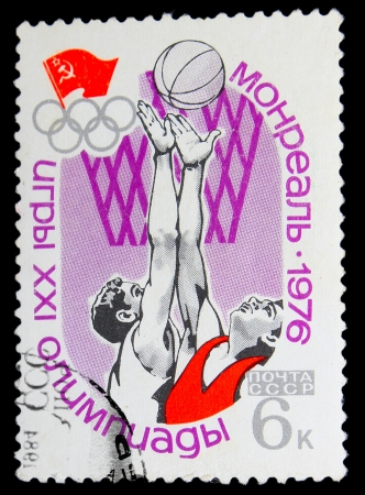 USSR - CIRCA 1976: A stamp printed in USSR, Summer Olympic Games in Montreal 1976 , basketball, two athletes play basketball, circa 1976 Stock Photo - 16895804