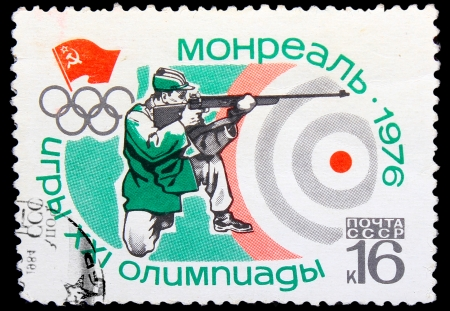 USSR - CIRCA 1976: A stamp printed in USSR, Summer  Games in Montreal 1976 ,  sports shooting, man shoots gun, circa 1976 Stock Photo - 16896376