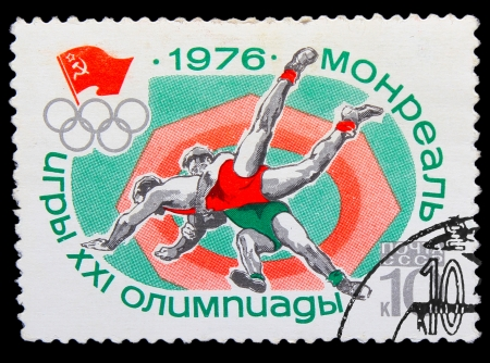 USSR - CIRCA 1976: A stamp printed in USSR, Summer in Montreal, wrestling, two wrestlers fighting in the ring, circa 1976 Stock Photo - 16896264