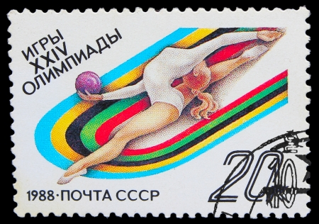 USSR - CIRCA 1988: A stamp printed in USSR, 14 Summer  Games , gymnastics, girl athlete jumps with the ball, circa 1988 Stock Photo - 16896227