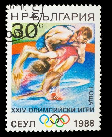 BULGARIA - CIRCA 1988: A stamp printed in BULGARIA, wrestling, 14  Games, circa 1988 Stock Photo - 16896327