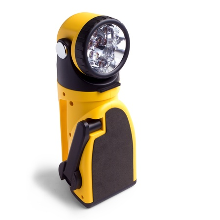 electric yellow pocket flashlight isolated on white background photo