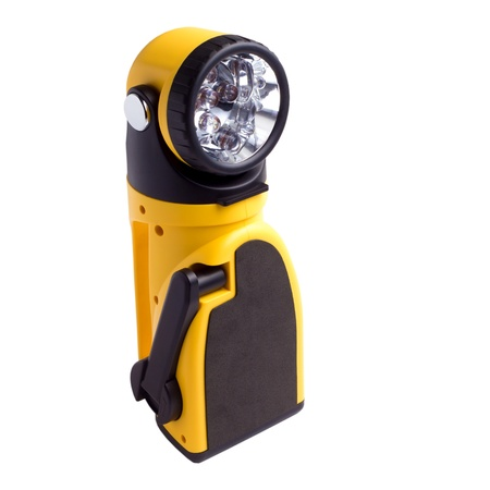 electric yellow pocket flashlight isolated  photo