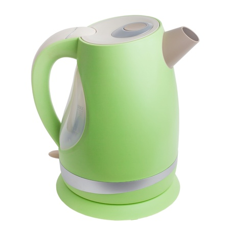 green electric kettle isolated on white background photo