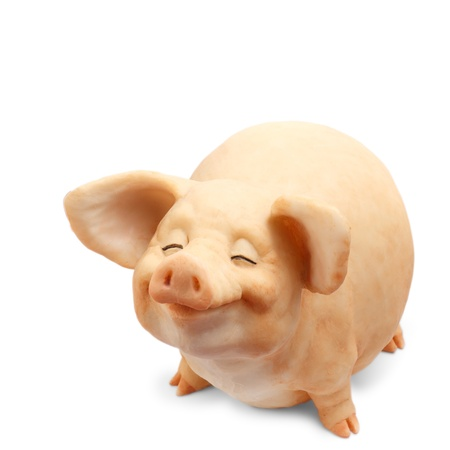pig figurine isolated on white background photo