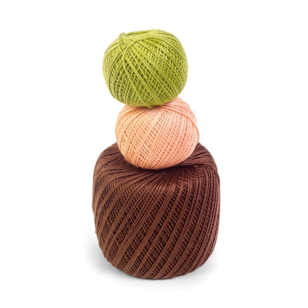 three colored balls of yarn for knitting isolated photo