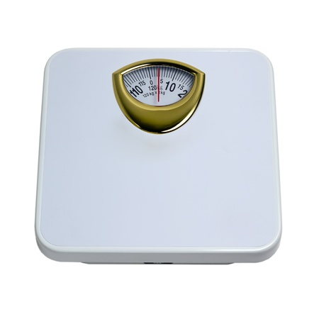weight control: weight control by floor scale isolated dieting concept Stock Photo