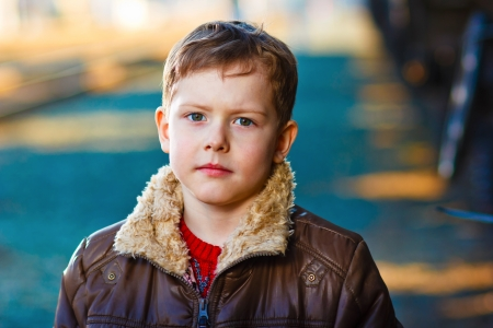 homeless sad blond abandoned alone child is boy on street in jacket Stock Photo - 16899300