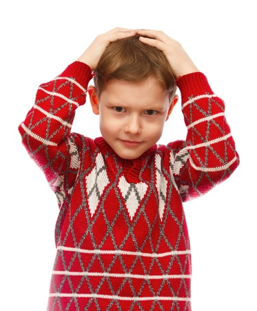 sad boy sadness holding his hands behind his head in the red sweater isolated photo