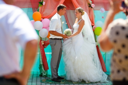 Bride blonde and groom newlyweds are on register ceremony content and cheerful smile photo